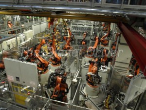 Here you see the Mobi-Cell with handling and welding robots. Robots perform spot welding with exacting precision.