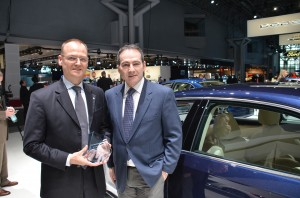 Rainer Michel of Volkswagen accepting the award from Jonathan Spira, The Diesel Driver